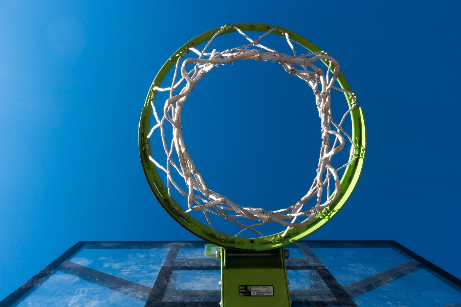 worm view photography of green and black basketall hoop